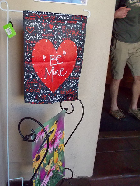 A BE MINE heart banner welcomes people at the door of the Balboa Park Visitors Center.