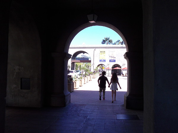 A pair holds hands as they enter Balboa Park on Valentine's Day.