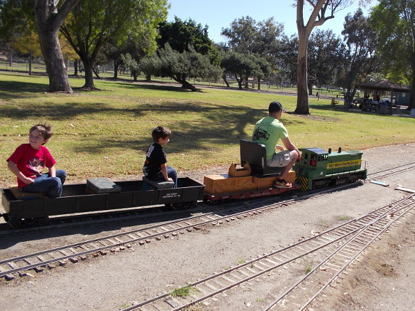 Thrilled kids ride behind a small diesel locomotive, which is actually powered by gasoline. The tracks looping through the park provide a fun, scenic ride.