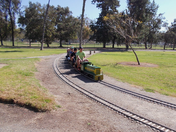 Here comes the same train. The Bonita Golf Course is in the distance, beyond the tracks.