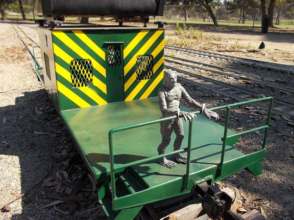 This caboose in the rail yard seems to be occupied by the Creature from the Black Lagoon!