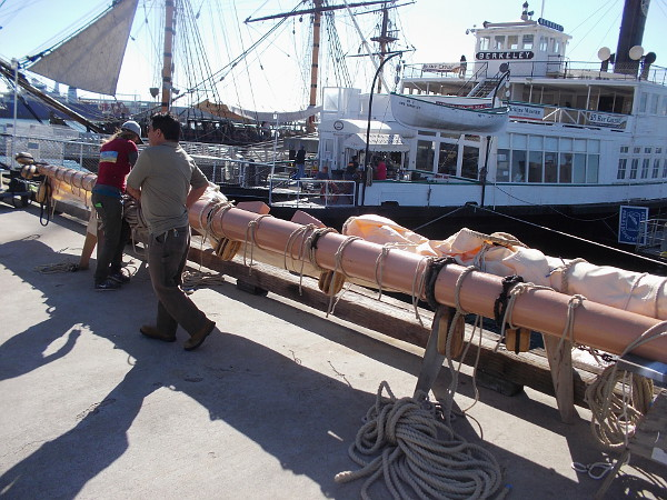 Another yard to be installed on the San Salvador by crane awaits on the Embarcadero. This heavy yard with sails furled will be supported by the replica Spanish galleon's foremast.