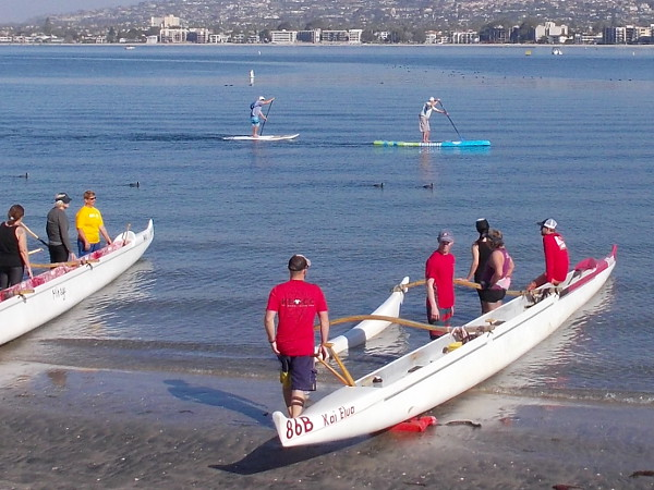 Some folks enjoying standup paddleboarding on Mission Bay also viewed the fascinating launch.