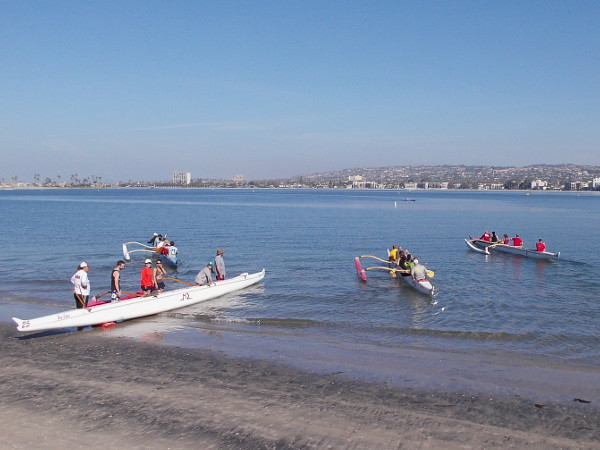 The four outrigger canoes are soon manned and afloat. They head out for a day of racing practice.