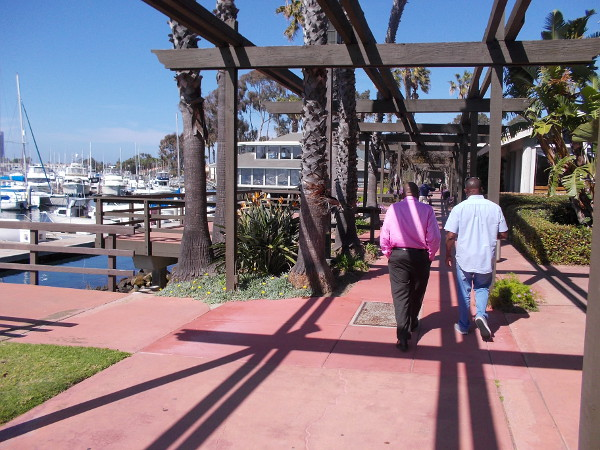 Visitors walk through Marina Village on Mission Bay.