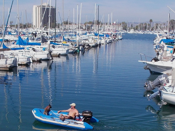 Kicking back with a best friend on the blue water. In the distance you can see the Hyatt Regency Mission Bay Spa and Marina.