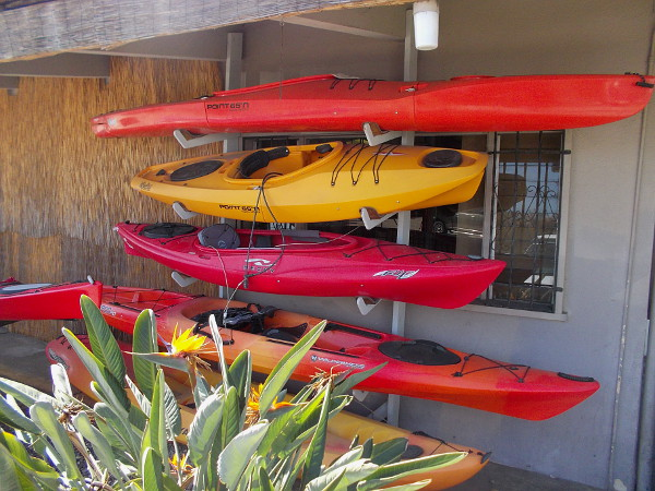 Colorful kayaks await at Aqua Adventures.