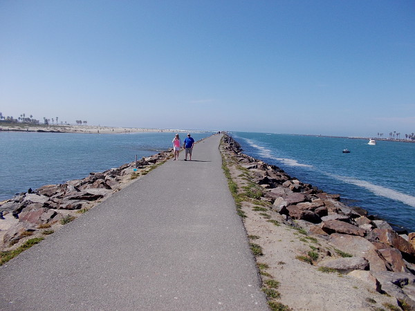 Walking along the jetty west of Hospitality Point. This narrow strip of land separates the San Diego River, to the left, from the man-made channel into Mission Bay. One can see a sliver of Ocean Beach, on the left, and Mission Beach, on the right.