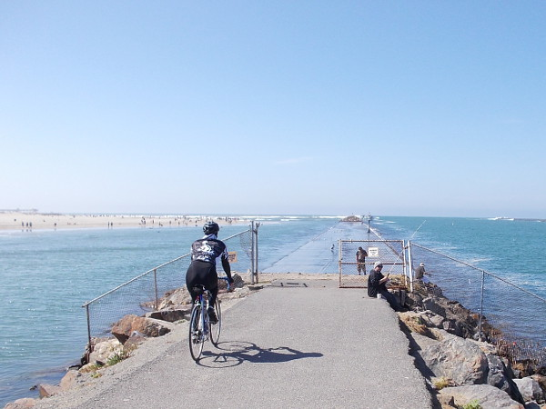 Bicycling along. Heading toward the end of the long jetty. It's a beautiful day. One can see forever.