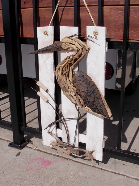 This cool artistic heron is part of the decor at the new outdoor cafe, tackle and bait shop.