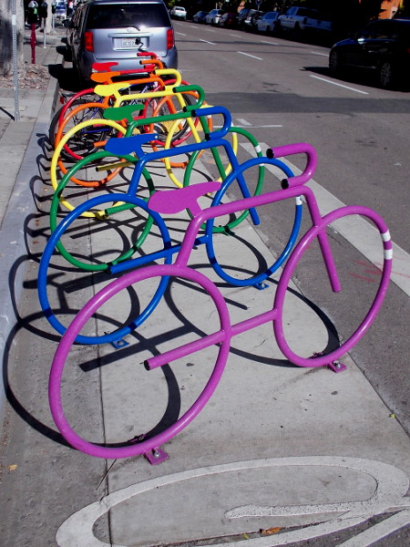 Colorful bike locking station invites bicyclists to ride up Fifth Avenue.