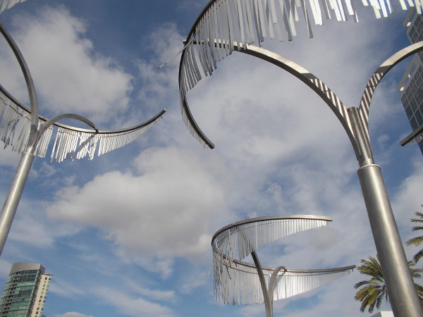 Seven curving metal palm trees rise into the beautiful San Diego sky in Bayfront Plaza.