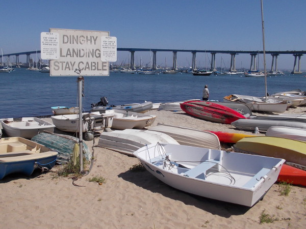 Dinghy landing and colorful boats by San Diego Bay at one end of Coronado Tidelands Park's popular beach.