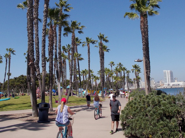 People walk and ride down the Bayshore Bikeway. Head the opposite way and you'd go under the Coronado Bridge, along Glorietta Boulevard and Coronado Golf Course, then finally south down the Silver Strand.