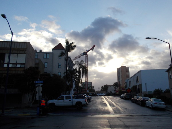 Looking east from Kettner Boulevard in downtown San Diego's beautiful Little Italy neighborhood. Morning clouds catch the rising sun after some nighttime sprinkles.