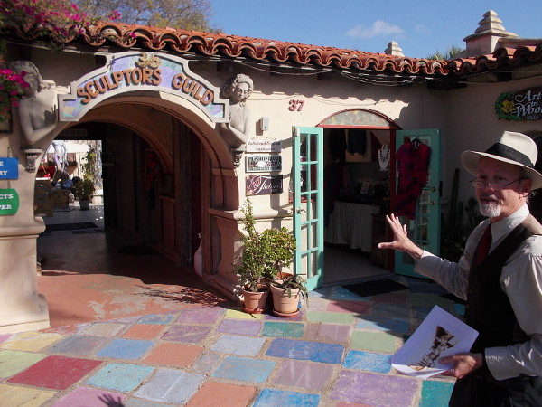 Tour guide Jeff explains that today's Studio 36 Sculpture Guild was an outdoor theatre in the early years of Spanish Village. The front was a lobby and ticket booth. Writers, actors and set designers would act out plays on the inner patio.