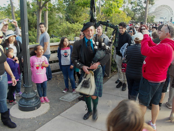 Bagpipe player attracts attention of visitors to San Diego's beautiful Balboa Park.