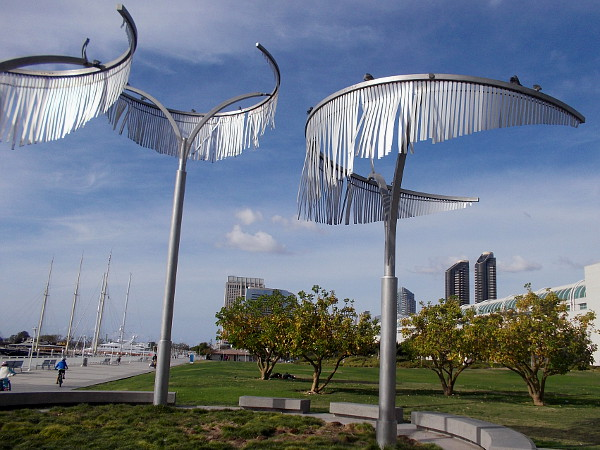 Silvery, sun-reflecting stainless steel ribbon leaves of the Wind Palms move very slightly in the sea breeze.