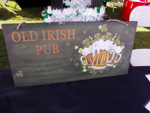 An Old Irish Pub sign at the big St. Patrick's Day Festival next to the parade route.