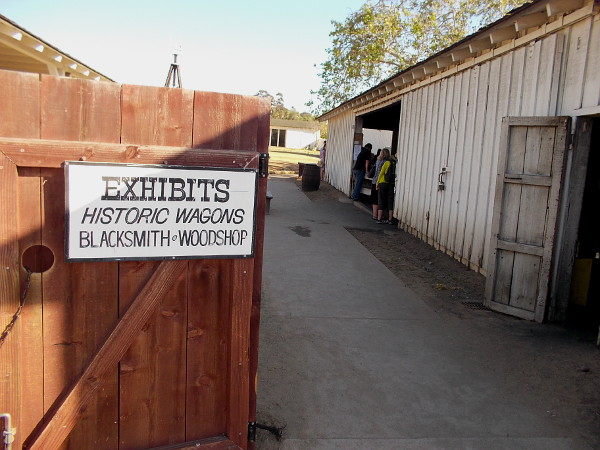 Beyond this gate just off La Plaza de Las Armas is the yard behind Seeley Stable. Here you'll find outdoor exhibits, including old wagons and a blacksmith and woodshop.