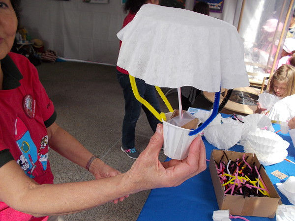 How to make a simple small parachute with a Dixie cup or object providing weight, string (or similar material) and coffee filter.