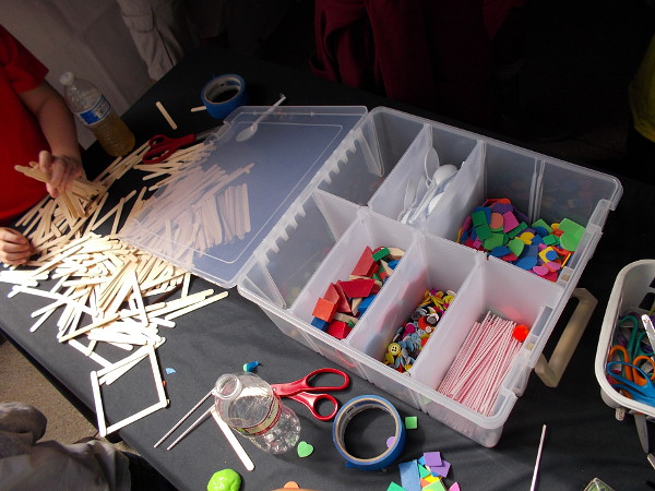 Objects you can use creatively include popsicle sticks, plastic spoons, straws, tubes, tape and buttons.
