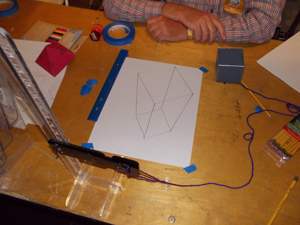After drawing the cube's base and drawing lines to connect the square with the projected corners, I ended up with this cool figure.