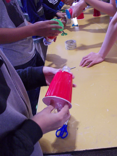 To make a vortex cannon, insert a cut water bottle into a plastic Solo cup.