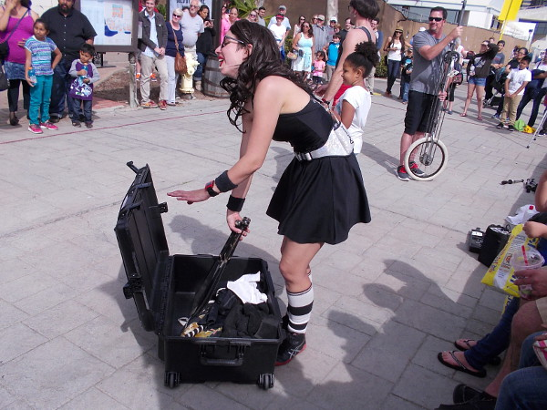A wicked-looking knife getting readied at the Seaport Village Spring Busker Festival!