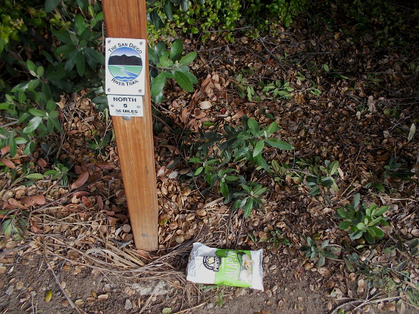 Litter carelessly dropped by a mile marker for The San Diego River Trail. It was picked up.