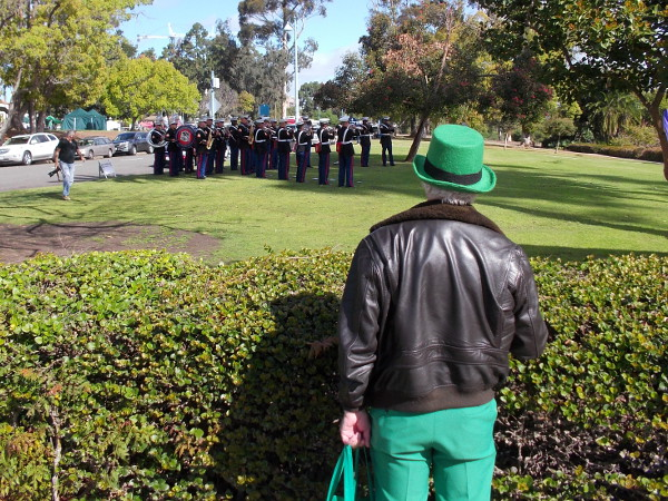 Someone watches as members of local United States Marine Corps band practice. Photo taken near Balboa Park's lawn bowling green.