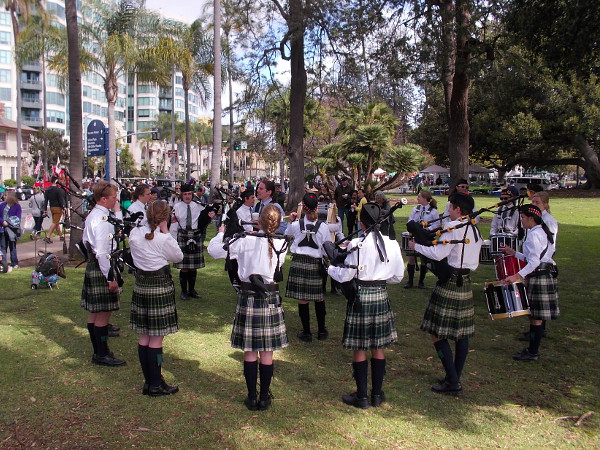 Bagpiper players and drummers form a circle as they practice for the big parade.