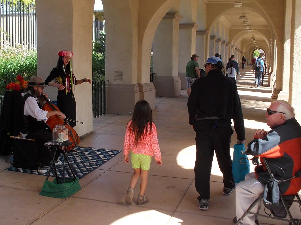Street musicians add magic to the park, entertaining both young and old.