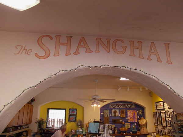 Studio 8, like many others in Spanish Village, was built out from the original open archway to provide more space for the artists. The words The SHANGHAI are from 1935. It evidently used to be a bar.