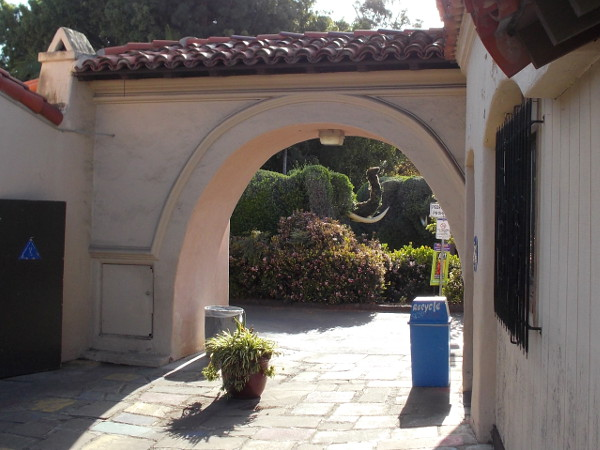 Looking through the west archway toward a shrub elephant, which stands on a nearby, newly improved walkway the heads north to the San Diego Zoo.