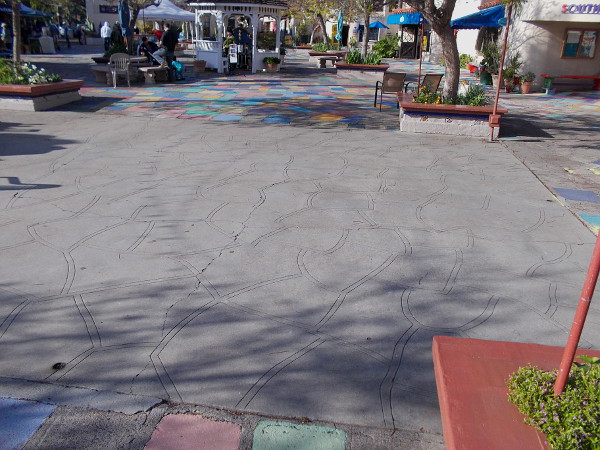This large dance floor (and the area where I'm standing) at the center of the colorful Spanish Village patio was once occupied by a large building. It seems there is some debate what that building was, exactly.