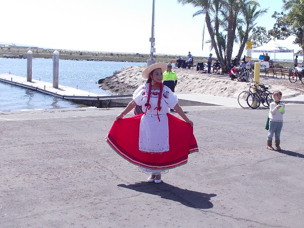 A cheerful dress on a beautiful day in San Diego's South Bay. A nearby boat ramp leads into the channel of the Sweetwater River.
