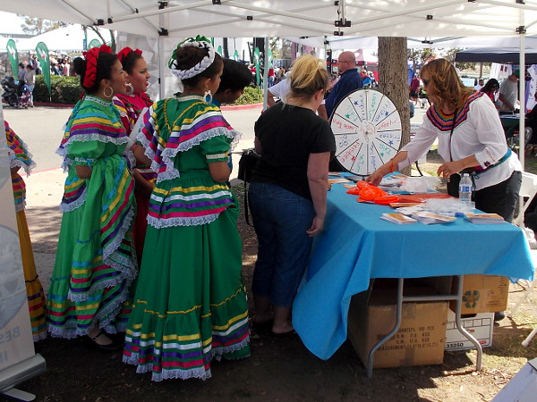 These ladies in costume were taking their turns at one of the festival's many prize wheels!