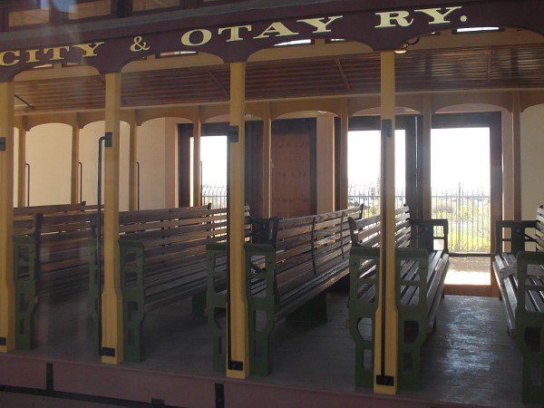 The restored coach features outdoor bench seating and beautiful woodwork. Passengers could ride this car from San Diego through National City and Chula Vista to the Mexican border.