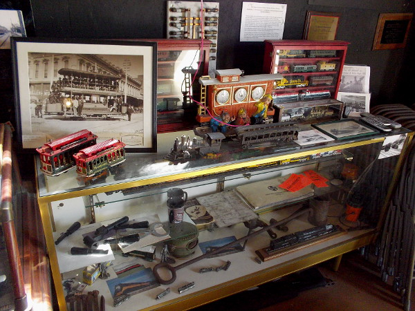 Inside the small depot are display cases full of model trains and streetcars, plus artifacts and memorabilia. The walls are covered with old photos and historical information.