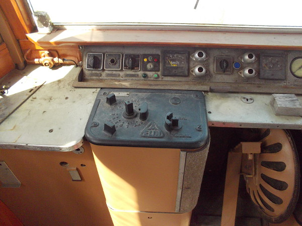The controls used by the electric streetcar operator. Notice the chair which folds under the dash.