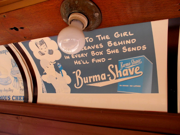 Cool vintage advertisements along the car's ceiling include this one for Burma-Shave.