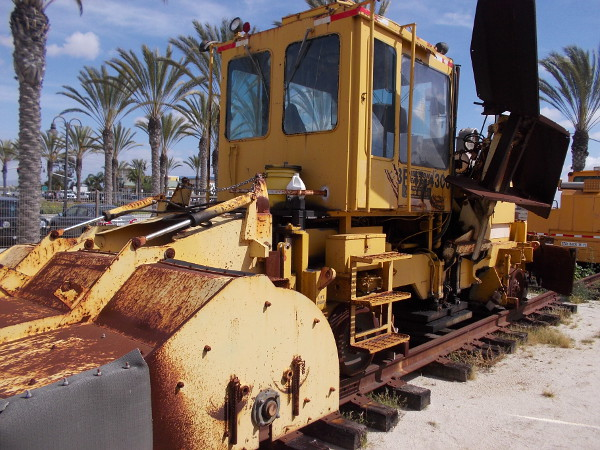 A big, heavy tamping machine used for maintaining railroad tracks and placing them more firmly onto packed ballast.