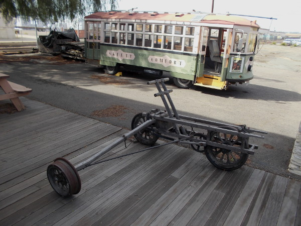 This unusual three-wheeled handcar reminds me of a canoe outrigger!