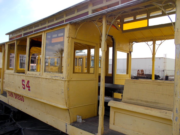 Elegant number 54 was operated by the San Diego Electric Railway Company according to its markings. The yellow paint is peeling.