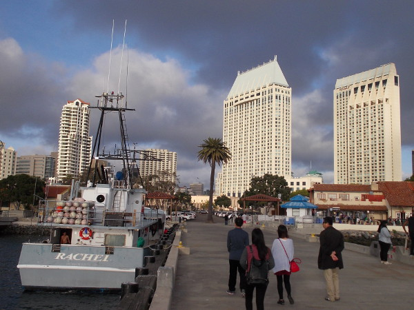 Late afternoon stroll on the pier between Tuna Harbor and Seaport Village. The Manchester Grand Hyatt towers are glowing in a dramatic sky.