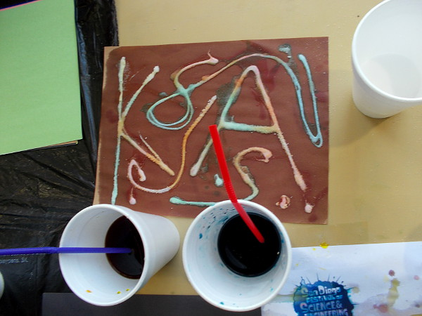 You can then use that colorful lava in the cup to make some colorful art! Awesome!