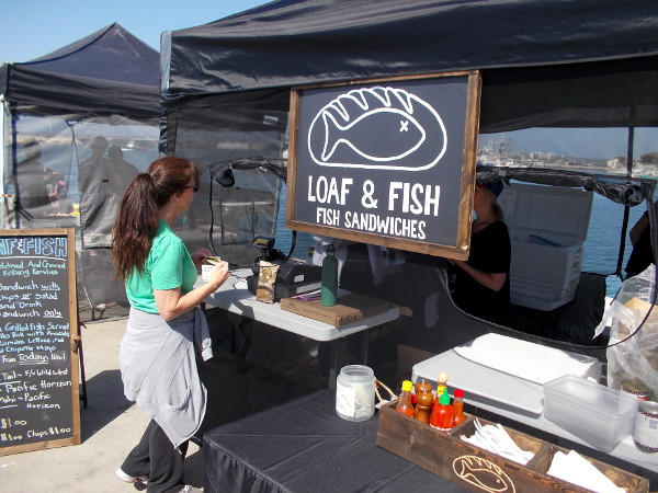 I saw a new canopy and sign at the ever-expanding Tuna Harbor Dockside Market. It's a food place called Loaf and Fish. They've got one of my favorite things!