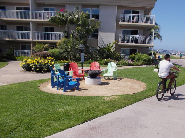 Colorful lounges and a fire pit for apartment dwellers near the Bayshore Bikeway.