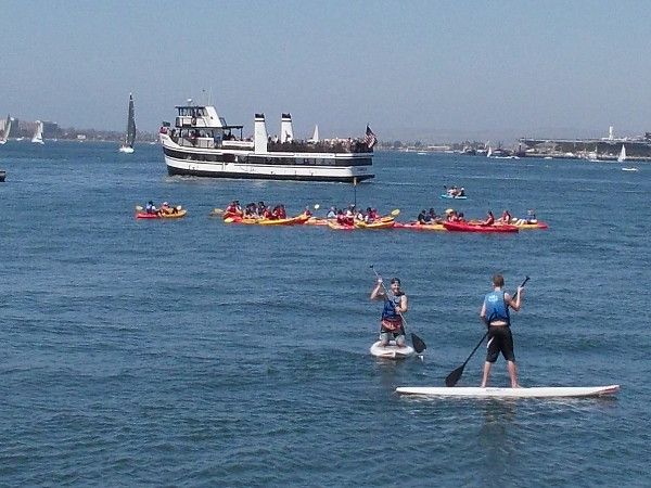 Look at all the weekend activity! Standup paddleboarders, a big group of kayakers, and the Coronado ferry!